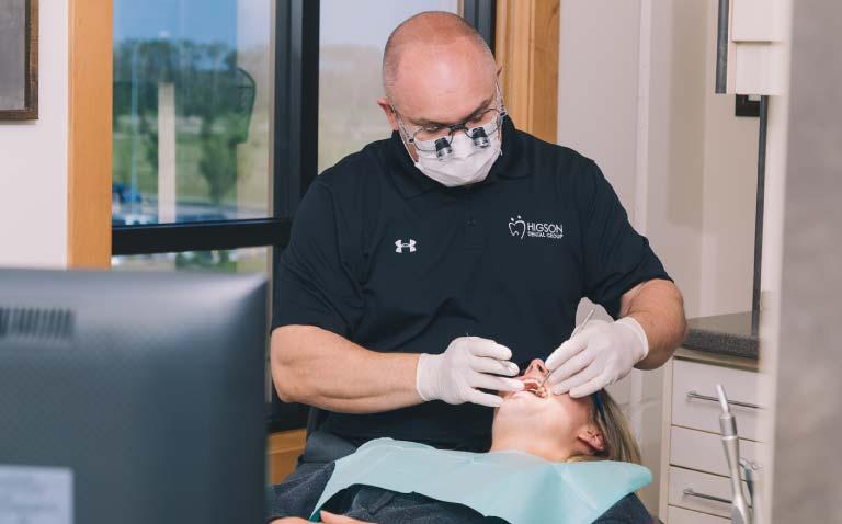 Higson Dental, Grande Prairie - Dentist and Patient