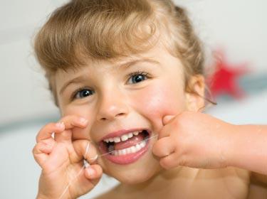 child flossing teeth Children's dentist near me
